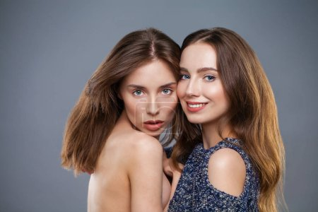 Photo for Close up -Two young models isolated on gray background - Royalty Free Image