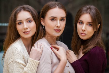 Photo for Make up  beauty. Three brunette young women, indoor - Royalty Free Image