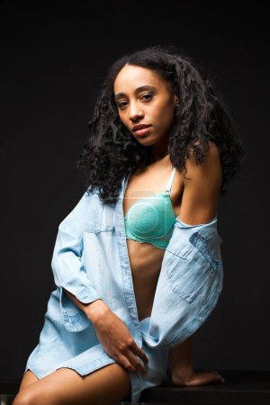 Sexy beautiful african american woman posing in bl...