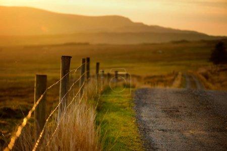 Irish countryside road leading towards mountains, County Galway, Ireland