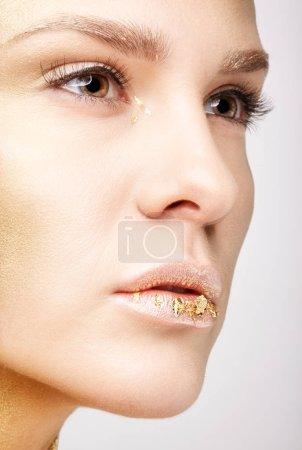 Closeup macro beauty portrait of young woman face.