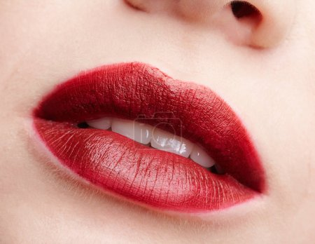 Closeup macro portrait of female red smiling lips with day beaut