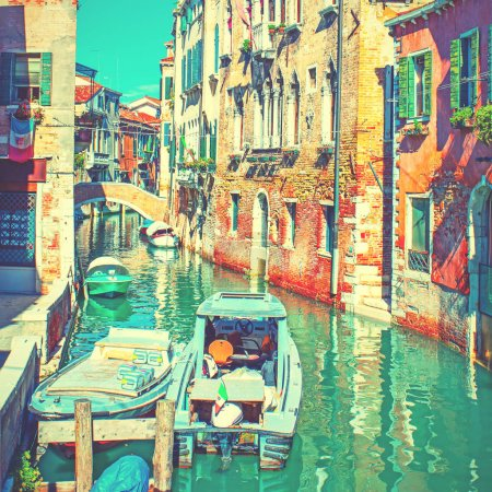 Photo for Narrow side canal with moored motorboats in Venice, Italy. Vintage style toned - Royalty Free Image