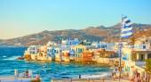 """Постер, картина, фотообои """"Панорамный вид на город Миконос и района Маленькая Венеция на закате, Киклады, Греция"""""""