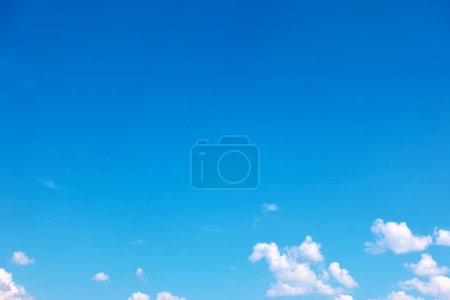 Photo for Blue almost clear sky with light white clouds - background with space for your own text - Royalty Free Image