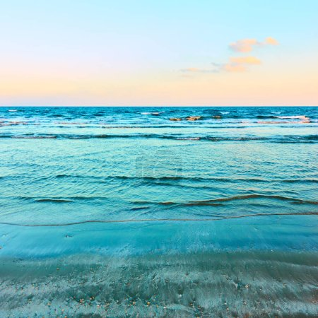 Photo for Sandy beach and the Mediterranean sea in the evening, may be used as background. Cyprus seascape - Royalty Free Image