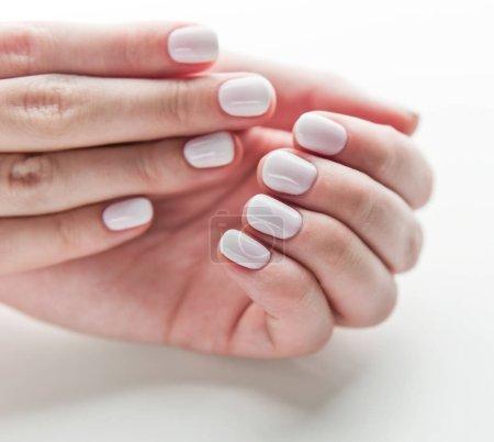 female hands, white manicure