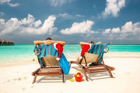 Photo for Couple on a tropical beach in Maldives at christmas - Royalty Free Image