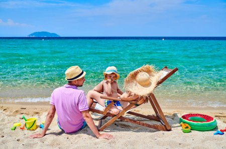 Photo for Family on beach, young couple with three year old boy. Sithonia, Greece - Royalty Free Image