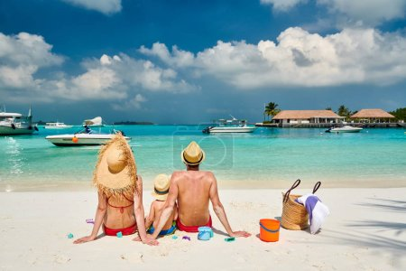 Photo for Family on beach, young couple with three year old boy. Summer vacation at Maldives. - Royalty Free Image