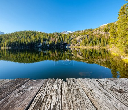 Photo for Bear Lake and reflection with mountains in snow around at autumn. Rocky Mountain National Park in Colorado, USA. - Royalty Free Image