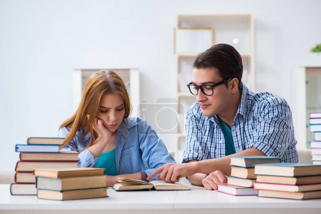 Photo for Pair of students studying for university exams - Royalty Free Image