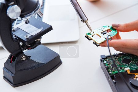 Photo for Engineer fixing broken computer hard drive - Royalty Free Image