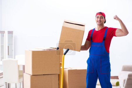 Photo for Contractor worker moving boxes during office move - Royalty Free Image
