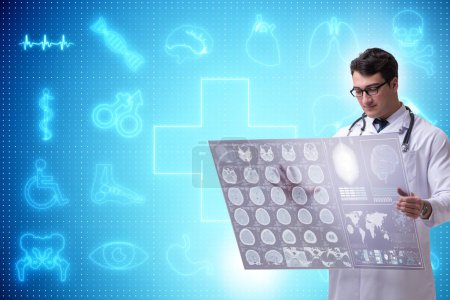 Photo for Telemedicine concept with doctor looking at x-ray image - Royalty Free Image