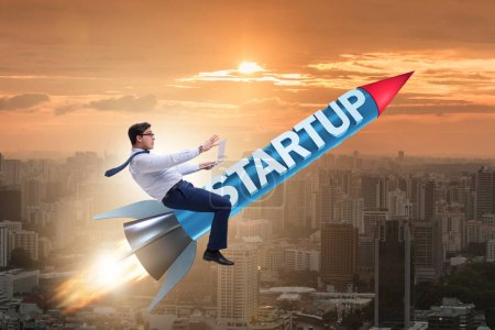 Photo for Businessman in start-up concept flying on rocket - Royalty Free Image