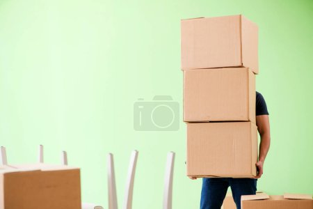 Photo for Man moving house with boxes - Royalty Free Image