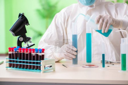Photo for Chemist working in the lab on new experiment - Royalty Free Image