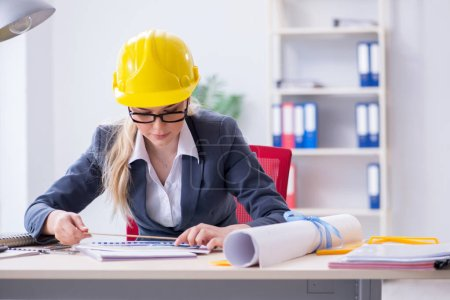 Photo for Woman architect working on the project - Royalty Free Image