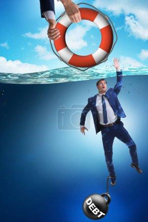 Photo pour Un homme d'affaires sauvé d'une dette élevée - image libre de droit