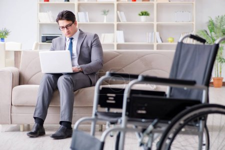 Photo for Disabled businessman on wheelchair working home - Royalty Free Image