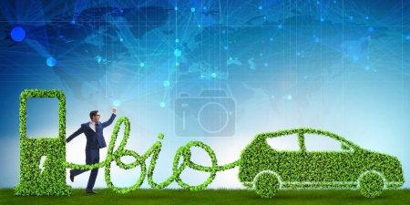Foto de Empresario con coche propulsado con biocombustible - Imagen libre de derechos