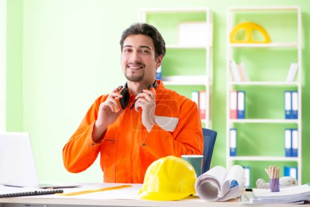 Photo for Construction supervisor planning new project in office - Royalty Free Image