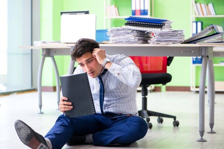 Photo for Frustrated businessman stressed from excessive work - Royalty Free Image