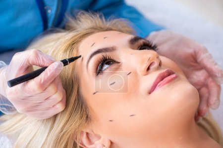 Photo for Woman getting ready for plastic surgery - Royalty Free Image