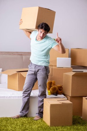 Photo for Young man moving to new apartment - Royalty Free Image