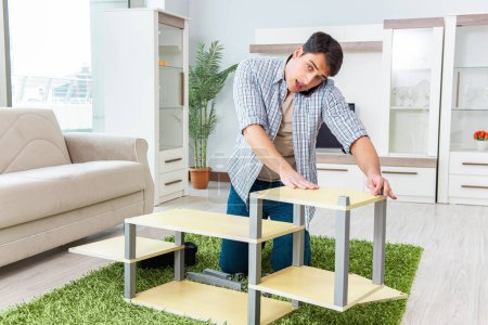 Photo for Man assembling furniture at home - Royalty Free Image