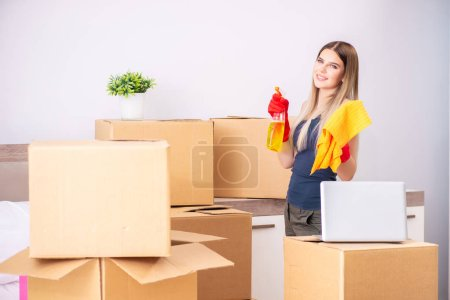 Photo for Young woman moving to new place - Royalty Free Image