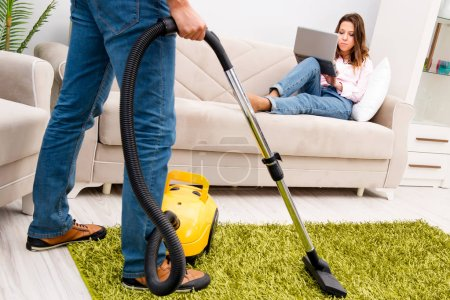Photo for Cleaning the house with vacuum cleaner - Royalty Free Image