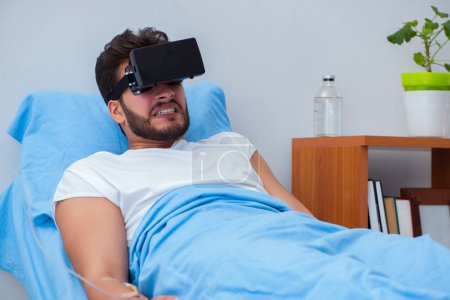 Photo for Patient in the hospital with VR glasses headset - Royalty Free Image