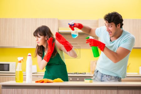 Photo for Young couple working at kitchen - Royalty Free Image