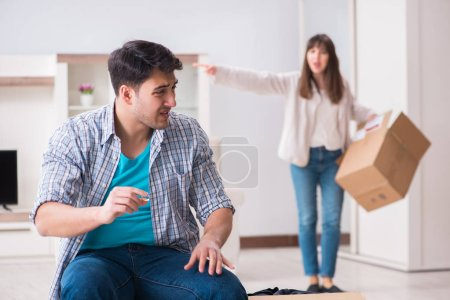 Photo for Woman evicting man from house during family conflict - Royalty Free Image