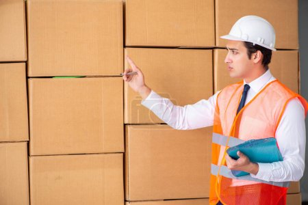 Photo for Man contractor working in box delivery relocation service - Royalty Free Image