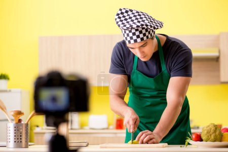 Photo for Young chef blogger explaining food preparation - Royalty Free Image