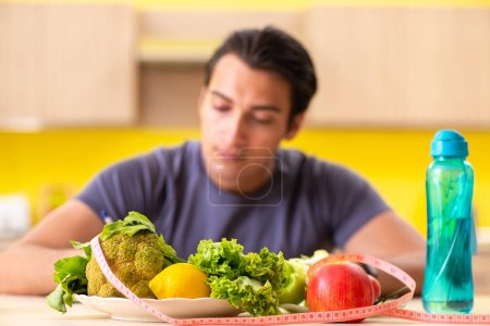 Photo for Young man in dieting and healthy eating concept - Royalty Free Image