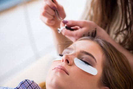 Photo for Young woman getting eyelash extension - Royalty Free Image