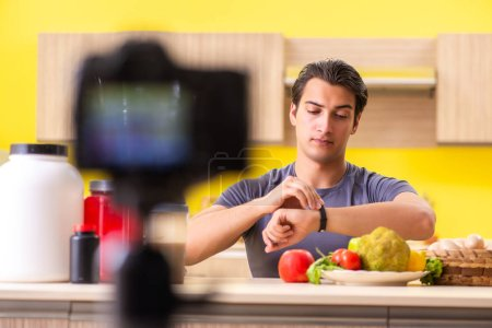 Young man blogging about food supplements