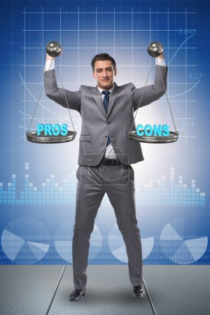 Photo for Businessman choosing pros and cons - Royalty Free Image