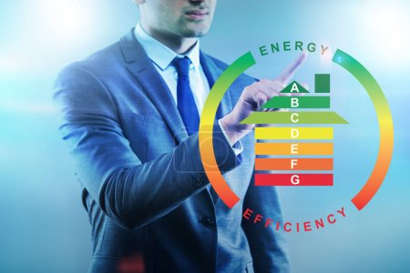 Foto de Empresario en concepto de eficiencia energética - Imagen libre de derechos
