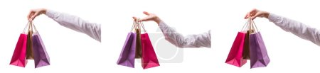 Photo for Hand holding shopping bags with christmas shopping on white back - Royalty Free Image