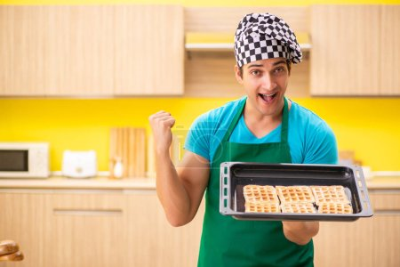 Photo for Man cook preparing cake in kitchen at home - Royalty Free Image