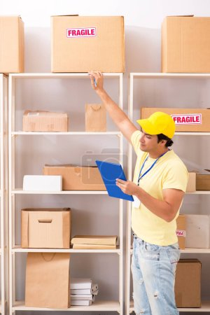 Photo for Handsome contractor working in box delivery relocation service - Royalty Free Image