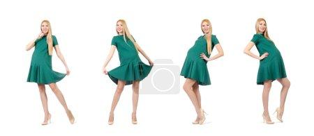 Photo pour Belle femme enceinte en robe vert isolé sur blanc - image libre de droit