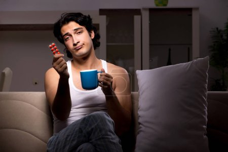 Photo for Young man suffering at home night time - Royalty Free Image
