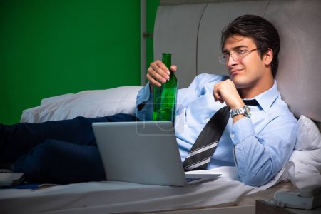 Photo for Young businessman under stress in the bedroom at night - Royalty Free Image