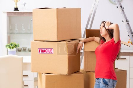 Photo for Young beautiful woman moving to new flat - Royalty Free Image